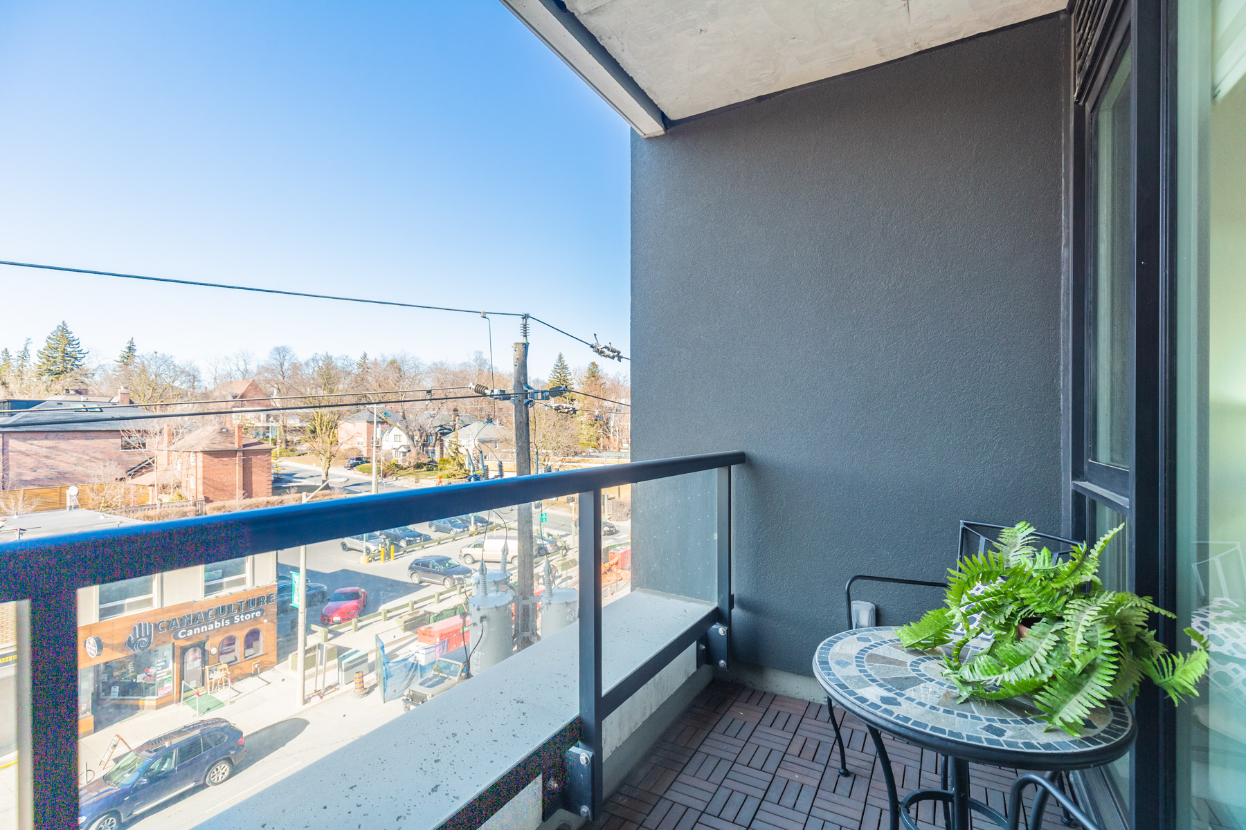 170 Chiltern Hill Rd Unit 410 balcony with parquet floors and glass panels.