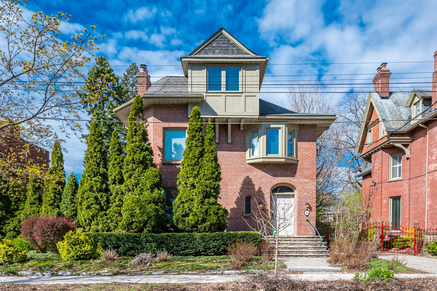 Front of 98 Bedford Rd, a 2-storey redbrick Victorian house.