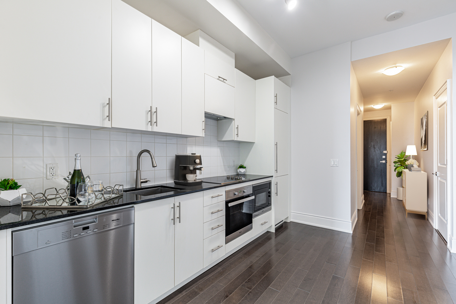 Condo kitchen stretching from wall to wall.