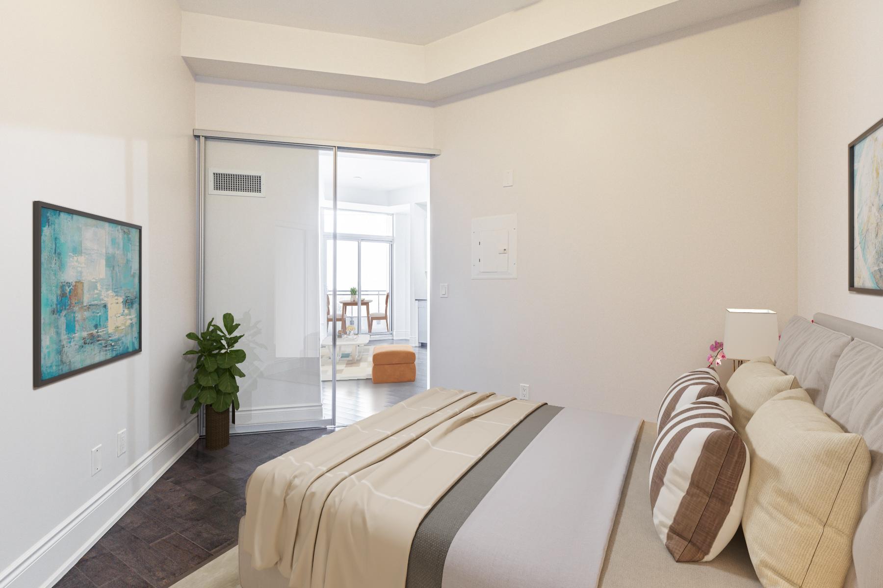 23 Glebe Rd W Unit 918 master bedroom with sliding glass doors.