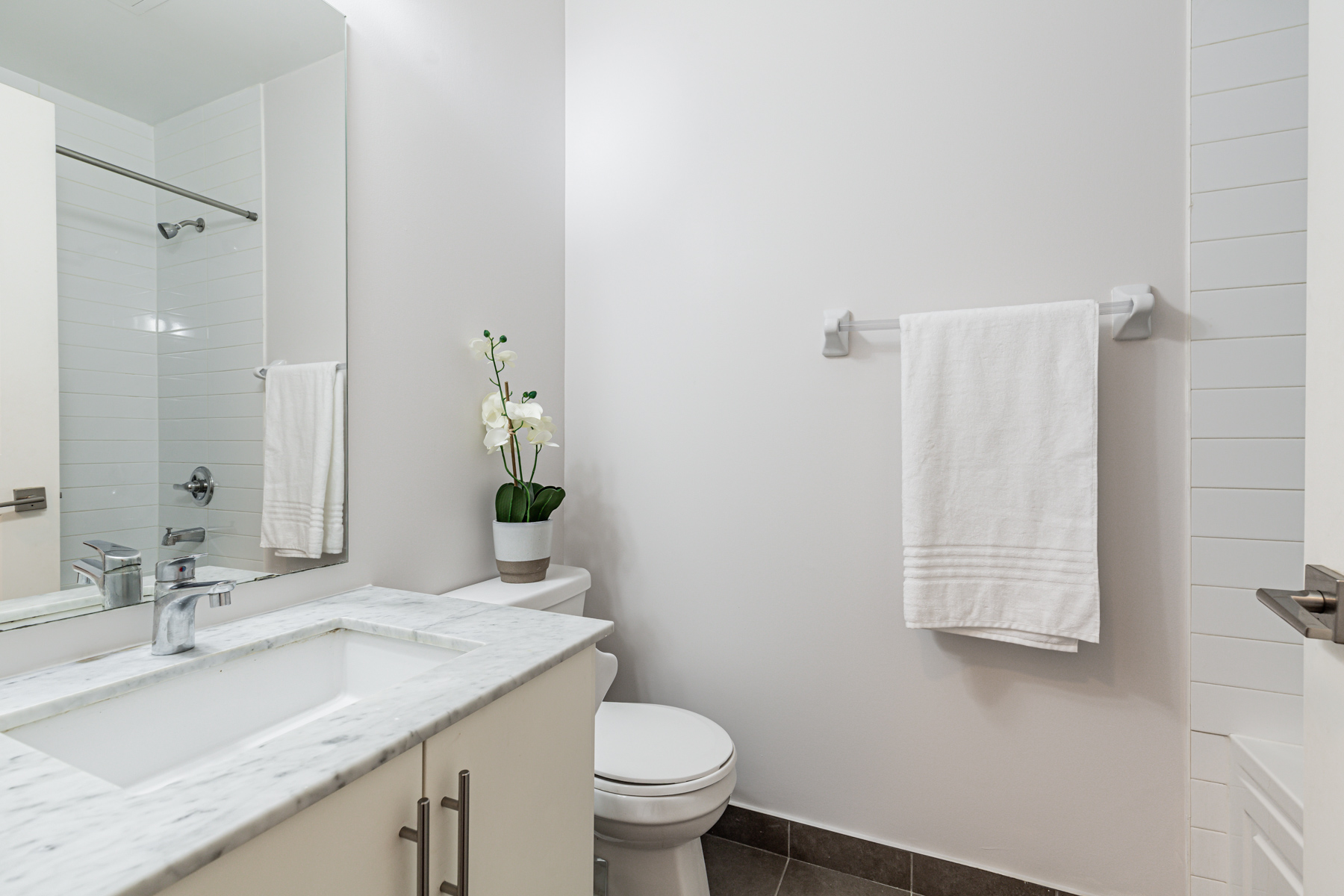 Newly painted gray 3-piece bathroom of 23 Glebe Rd W Unit 918.