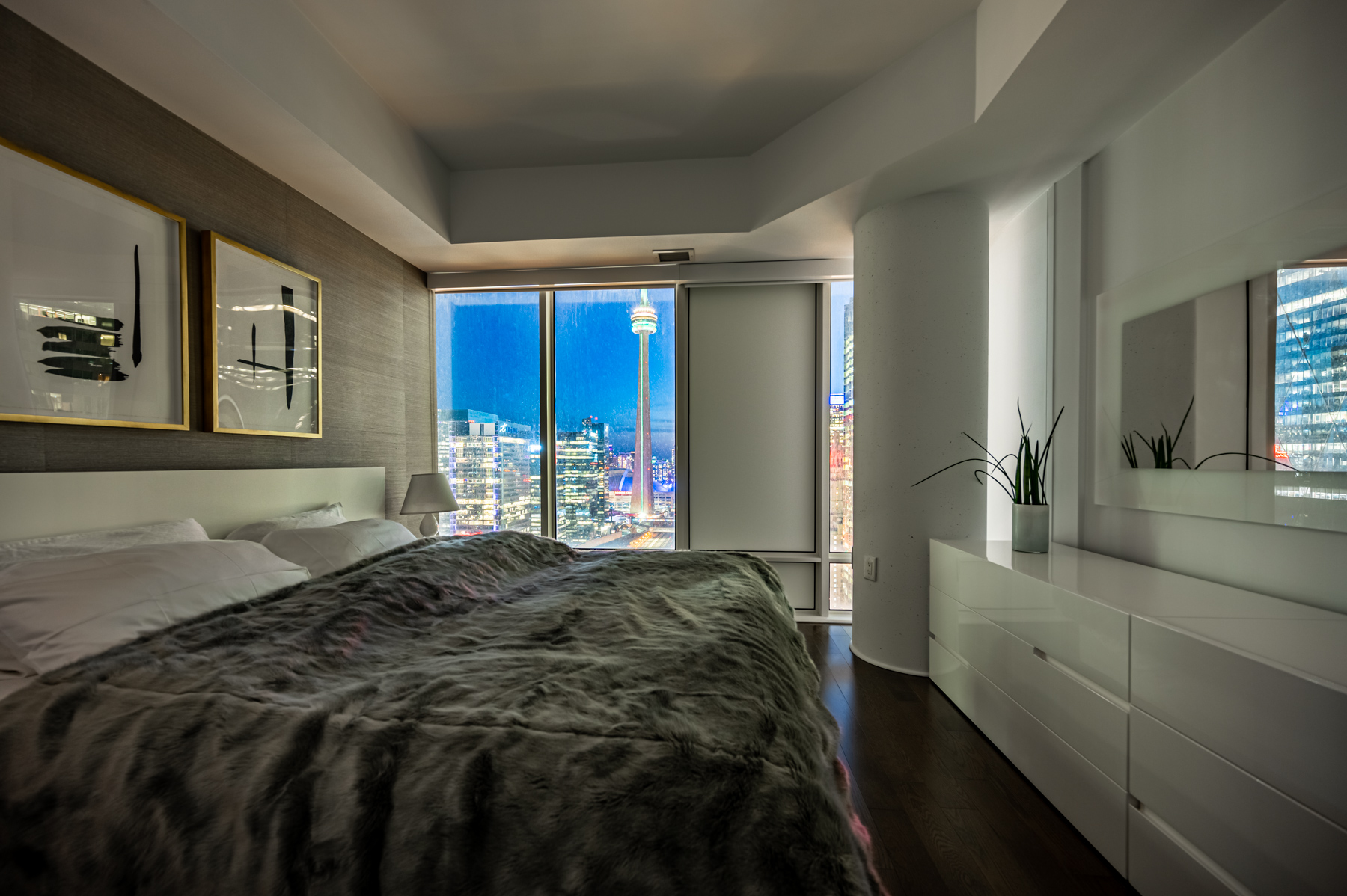 View of CN Tower lights from 8 The Esplanade Ave Unit 3305 master bedroom.