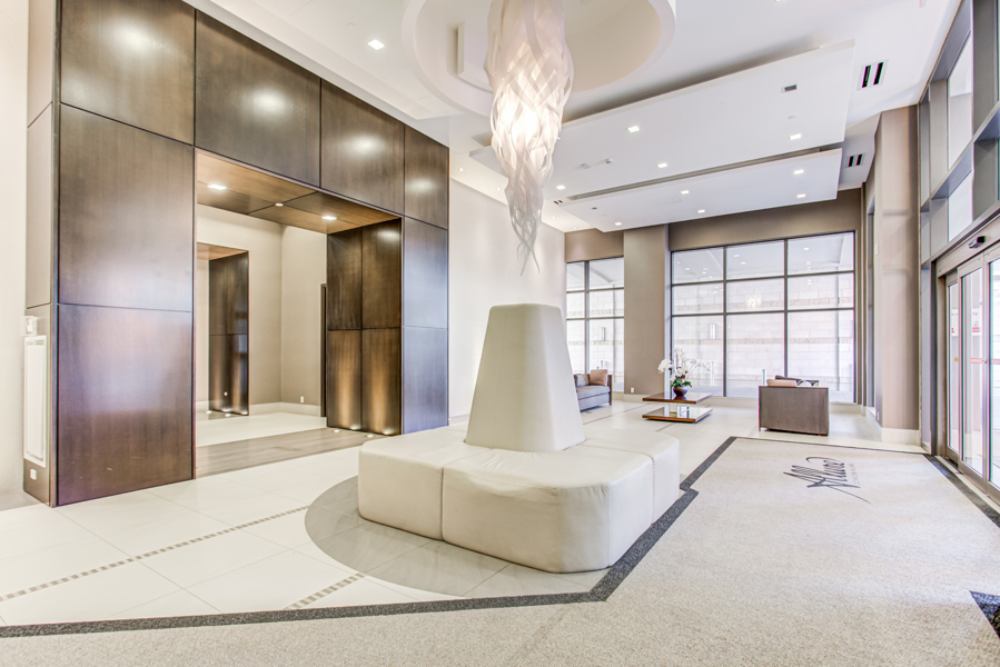 Allure Condos – sophisticated lobby with chic lighting and furniture.