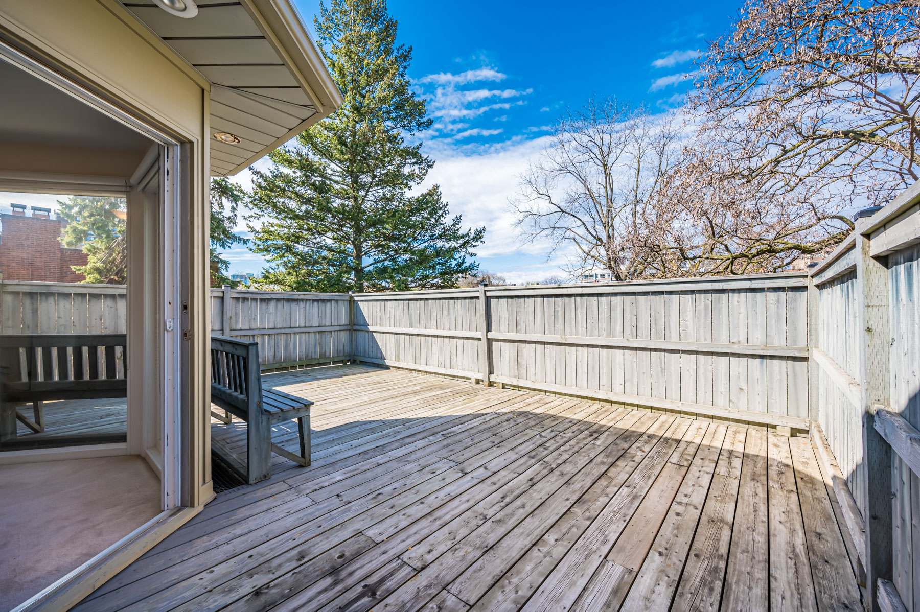 Wood deck with walls and recessed lights.