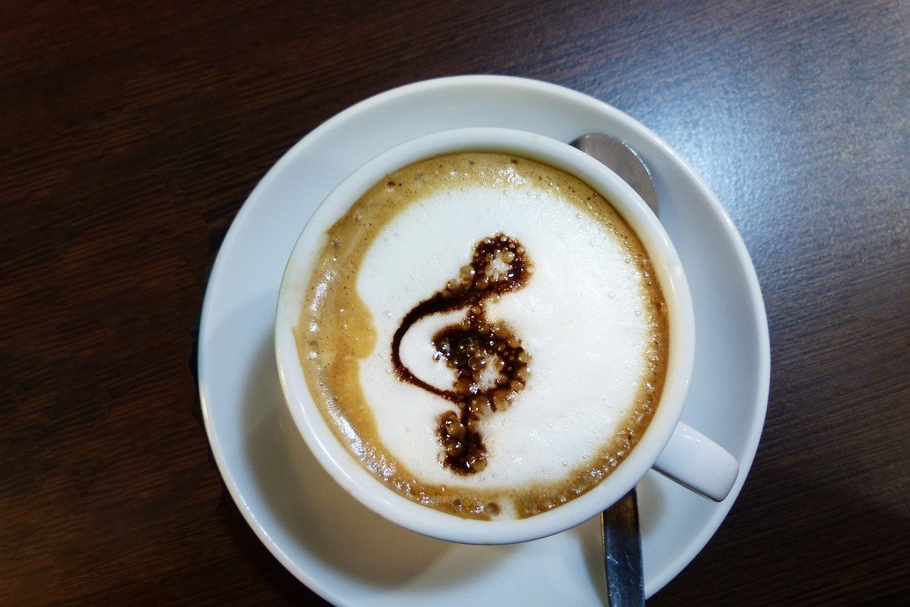 Cup of coffee decorated with chocolate musical note.