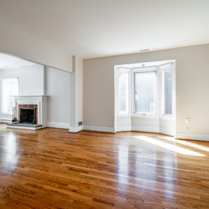 98 Bedford Rd – large living and dining room with hardwood floors and fireplace.