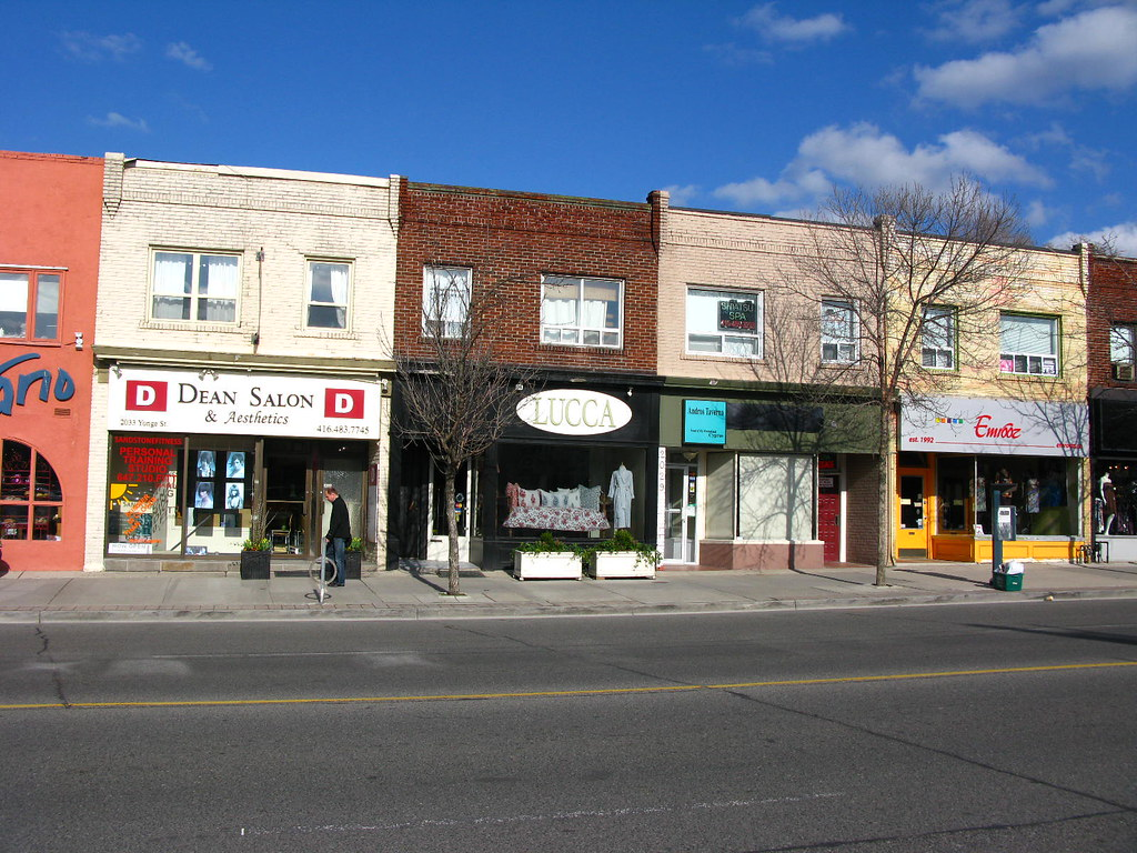 Small business storefronts along Yonge and Eglinton in Toronto.