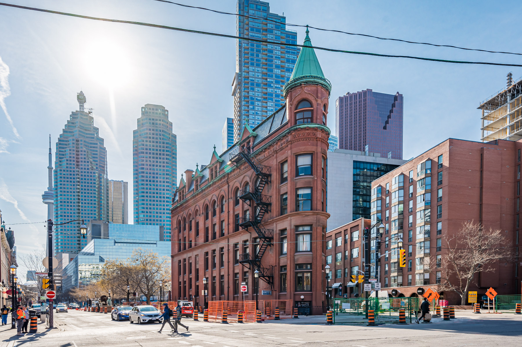 The Gooderham red brick flatiron building in Toronto with CN Tower in background.