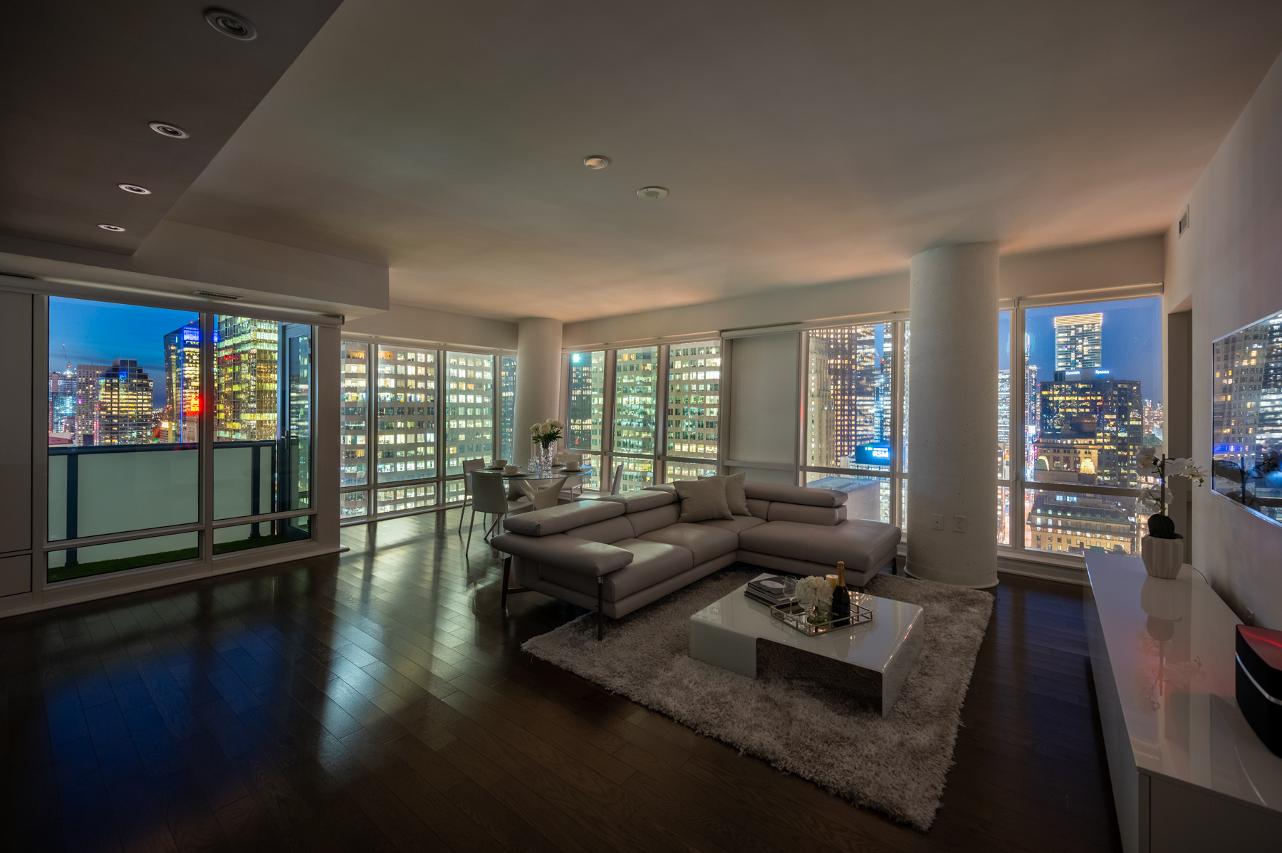 Condo living room lit by light from buildings.