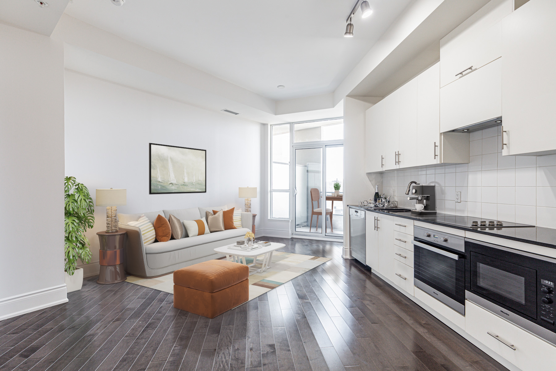 Open-concept condo with view of living, dining and kitchen areas.