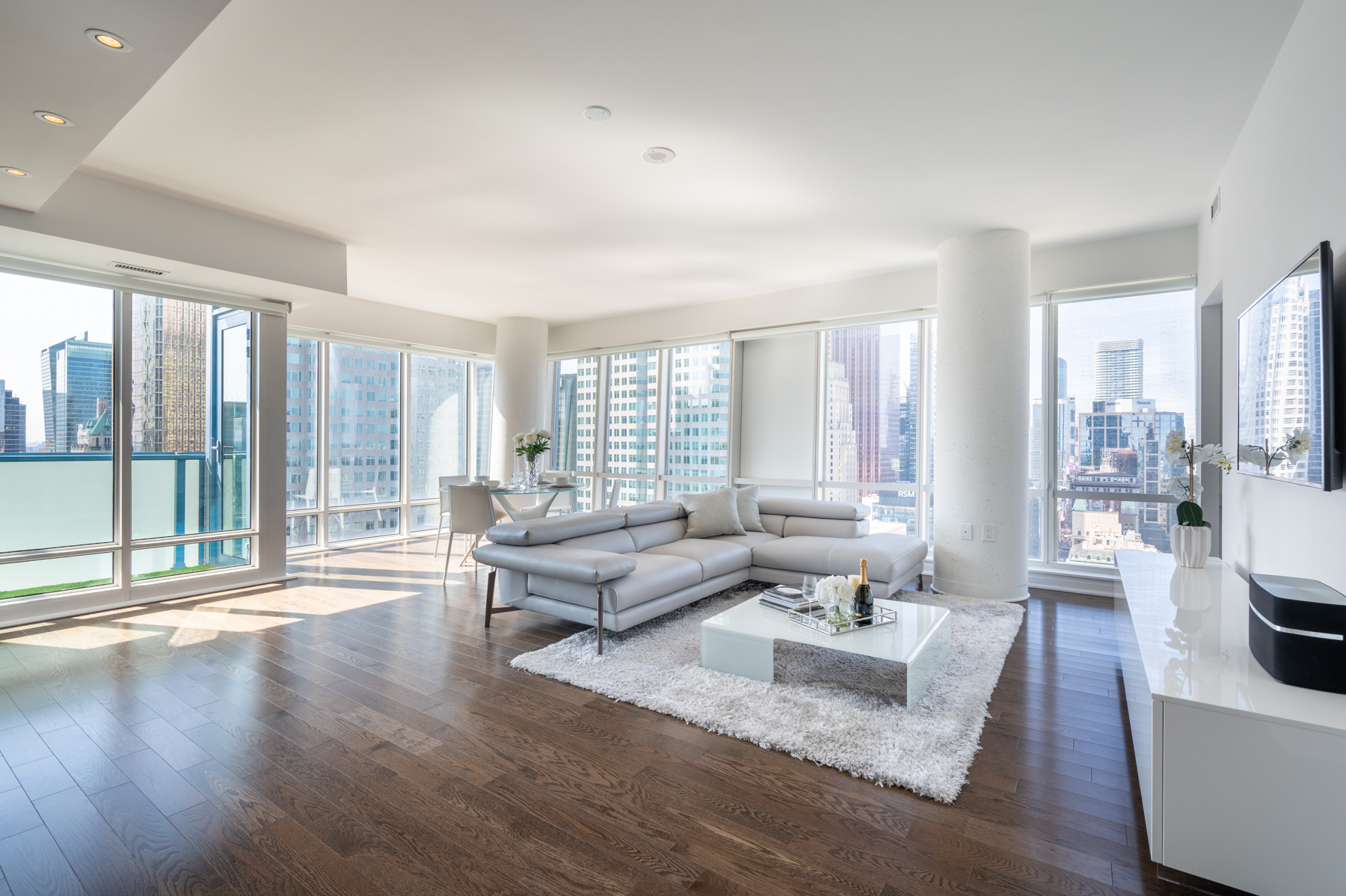Condo with huge windows and hardwood floors.