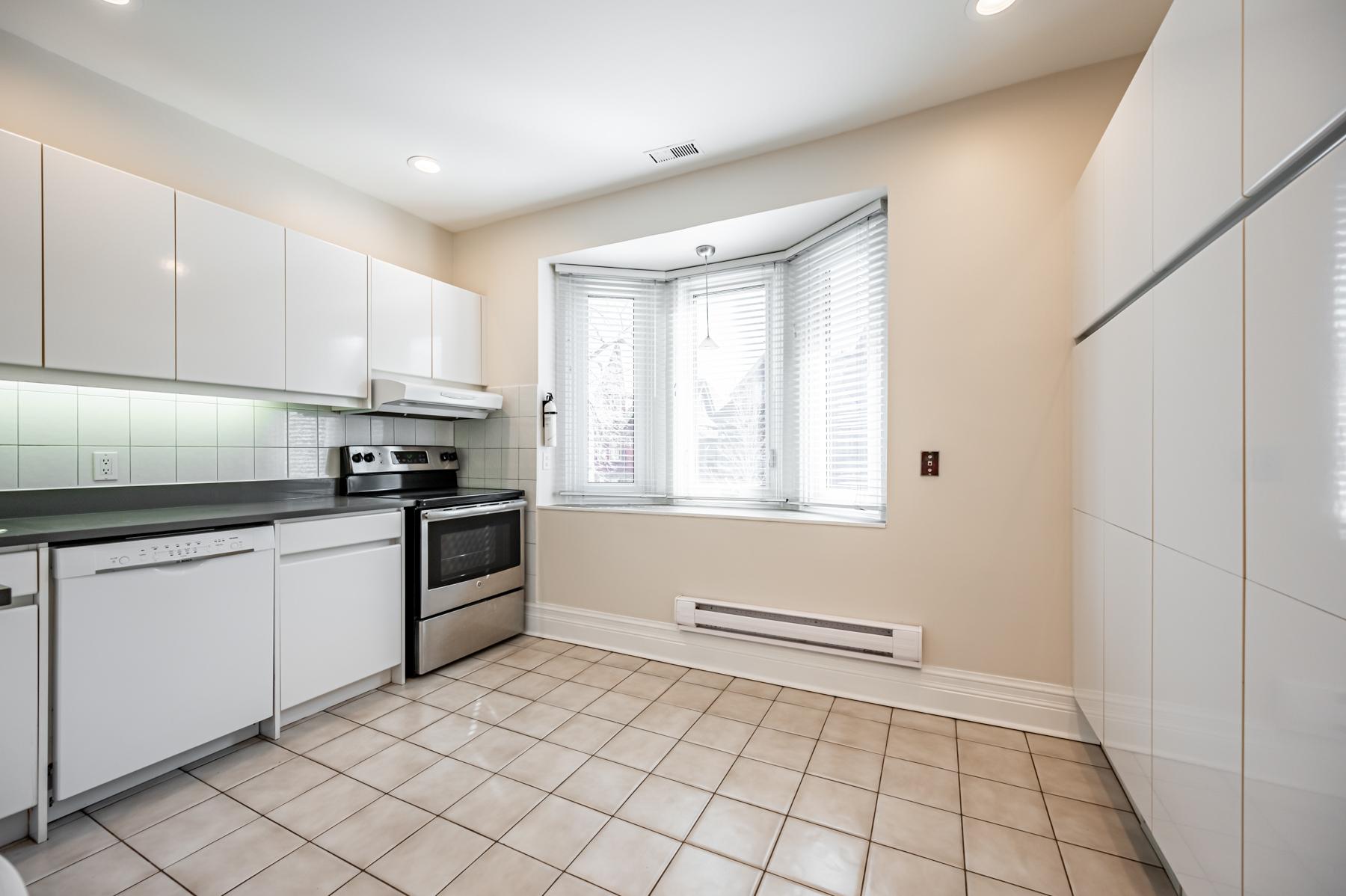 Kitchen with bay windows.