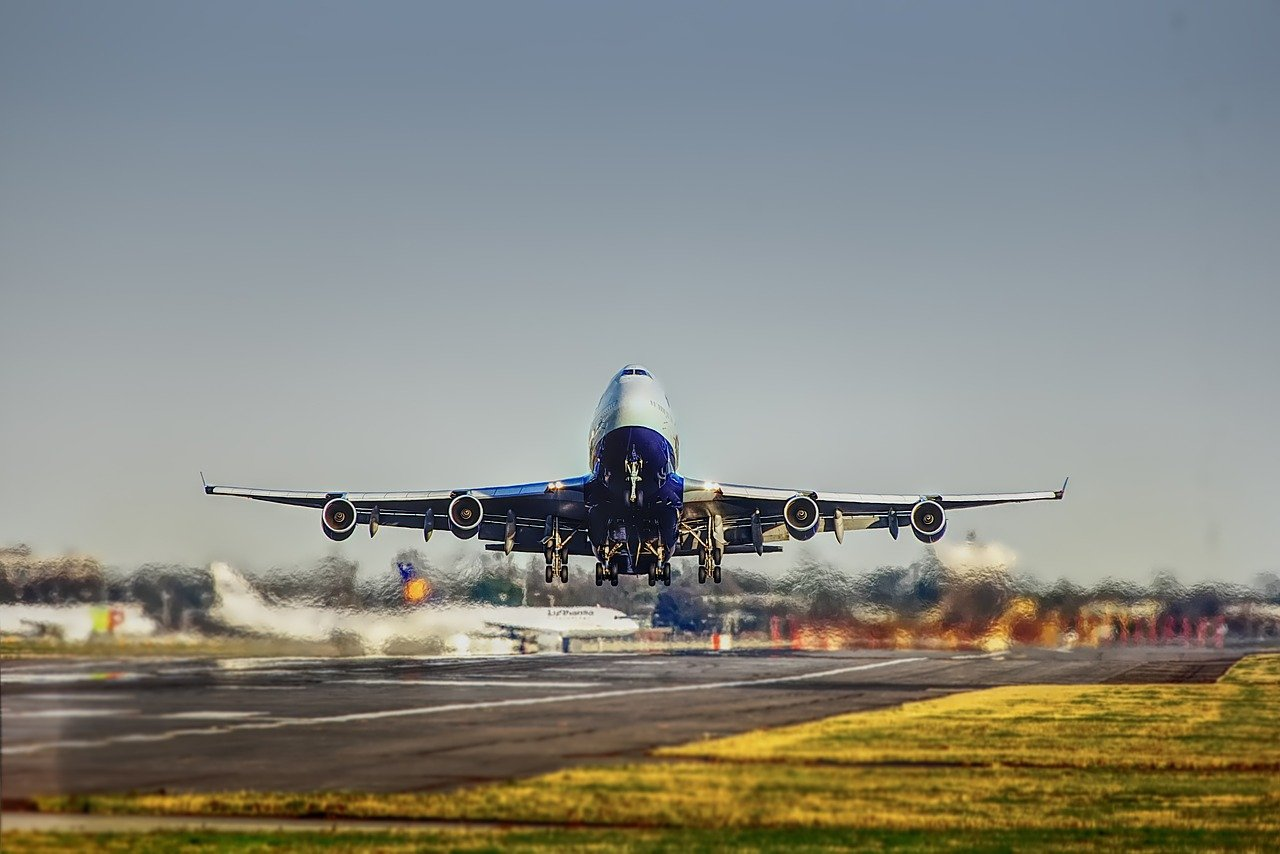 Airplane taking off from tarmac.