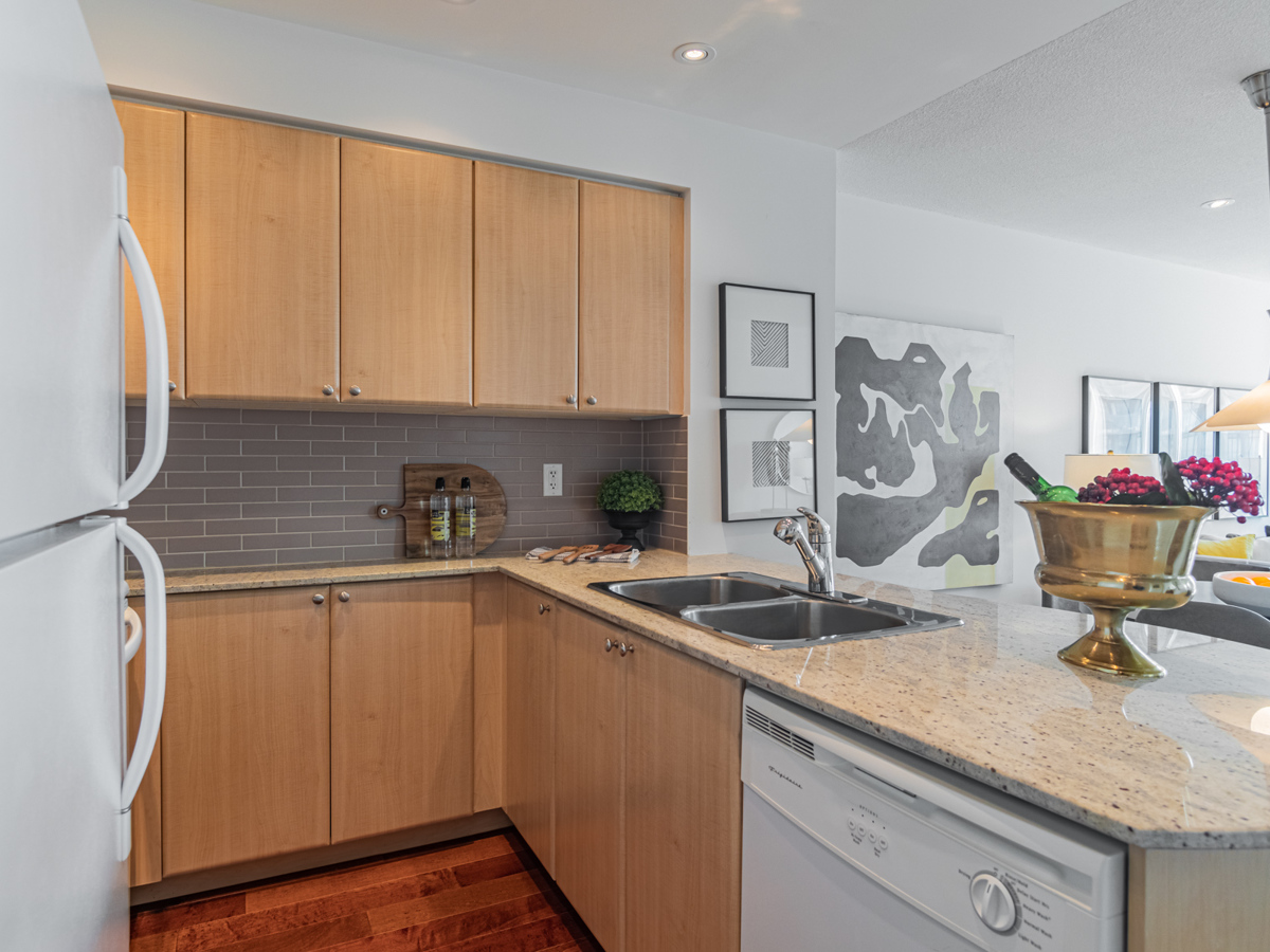 Kitchen with shiny granite counter and stainless-steel sink.