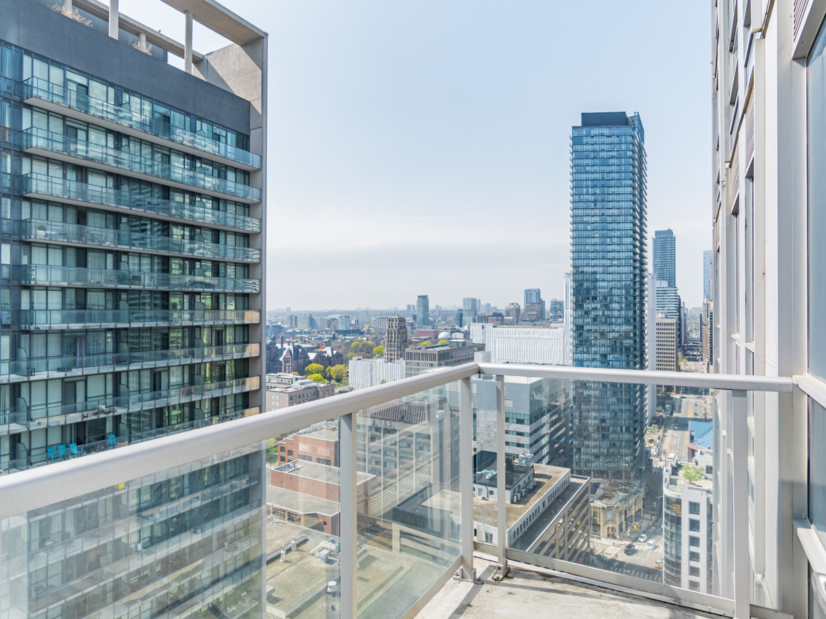 763 Bay St Unit 3111 open sky balcony with clear glass panels.