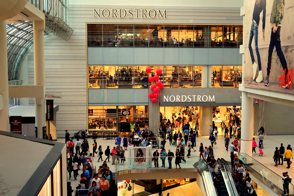 Crowd in front of Nordstrom storefront at Toronto Eaton Centre.