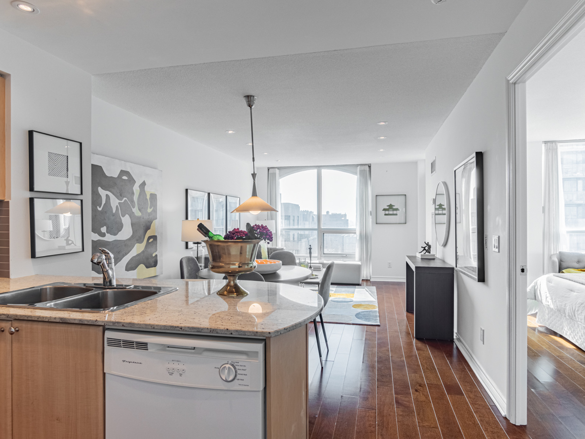 Brightly lit 763 Bay St Unit 3111 kitchen, living room and dining room.