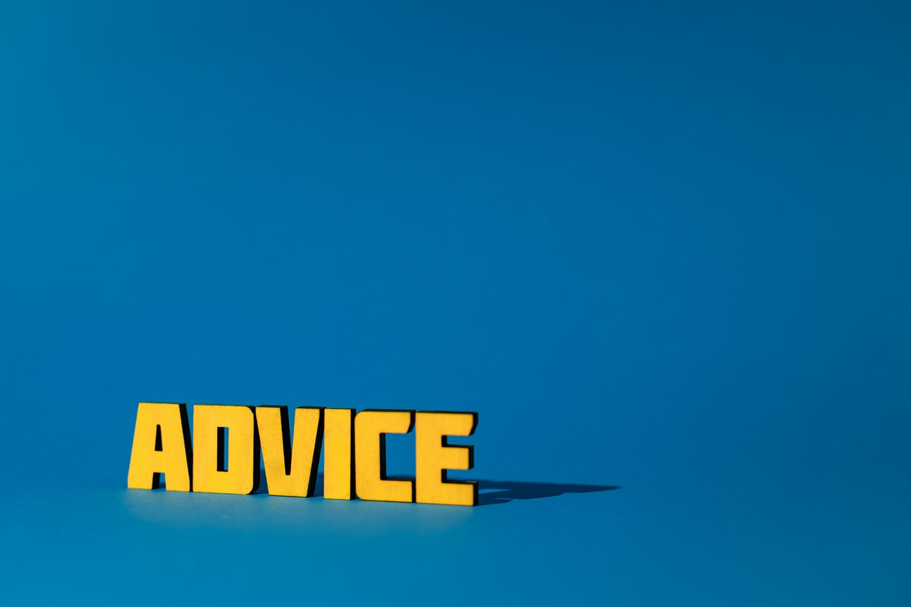 Word ADVICE in yellow letters on blue background.