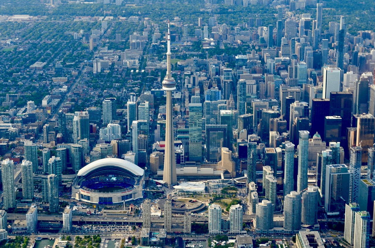 Toronto skyline and buildings showing impact of permanent residency programs.