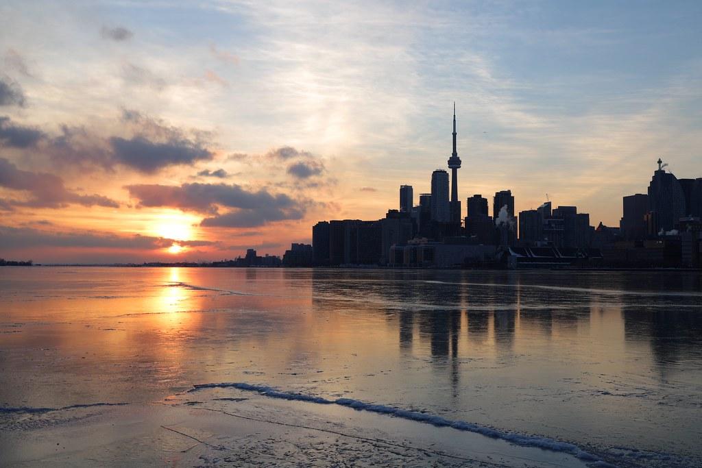 Winter sunset over Toronto's Lake Ontario and CN Tower.
