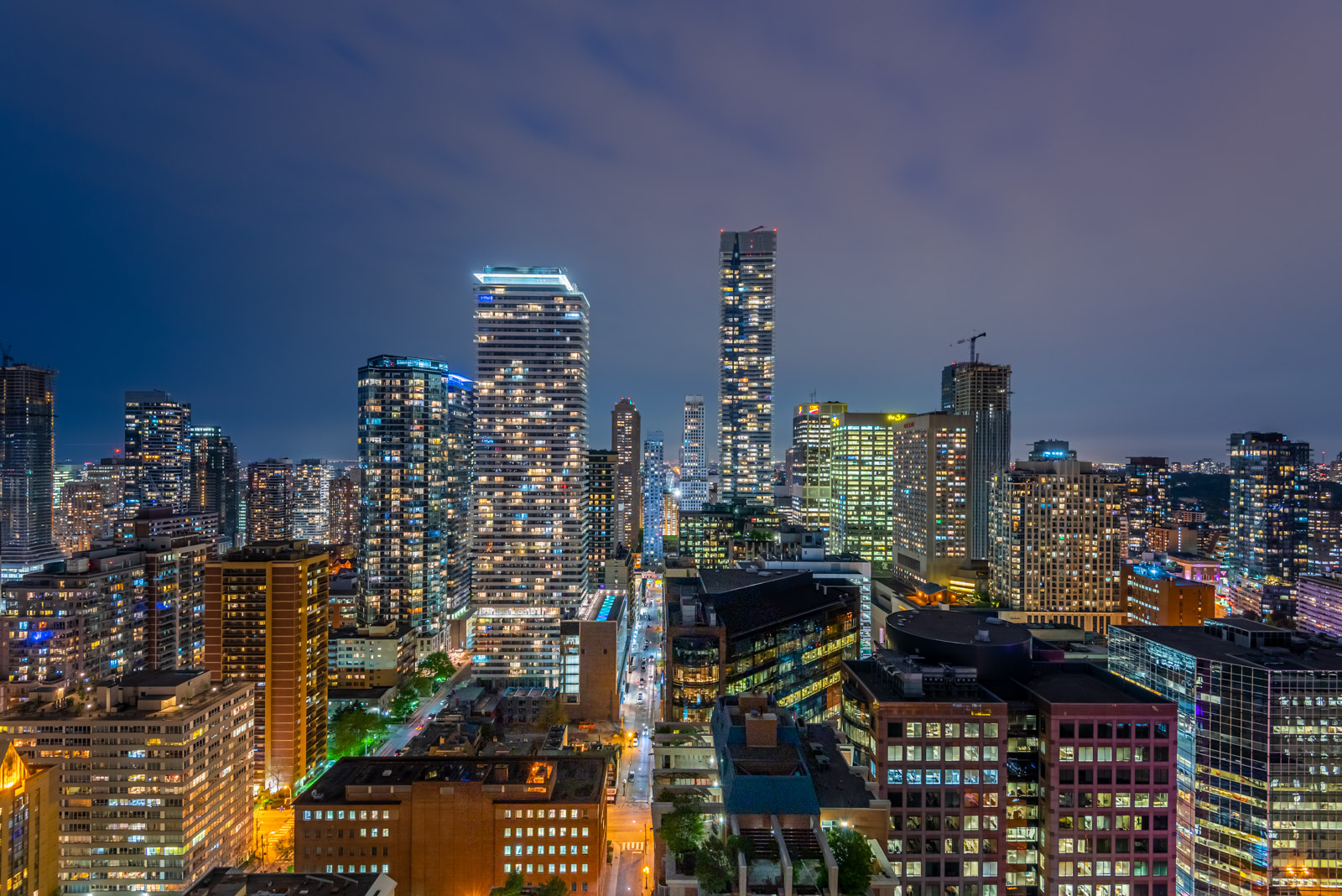 Building lights in Downtown Toronto at night.