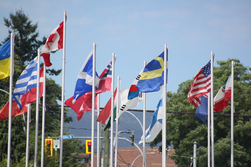 World flags depicting foreign investors from different countries.
