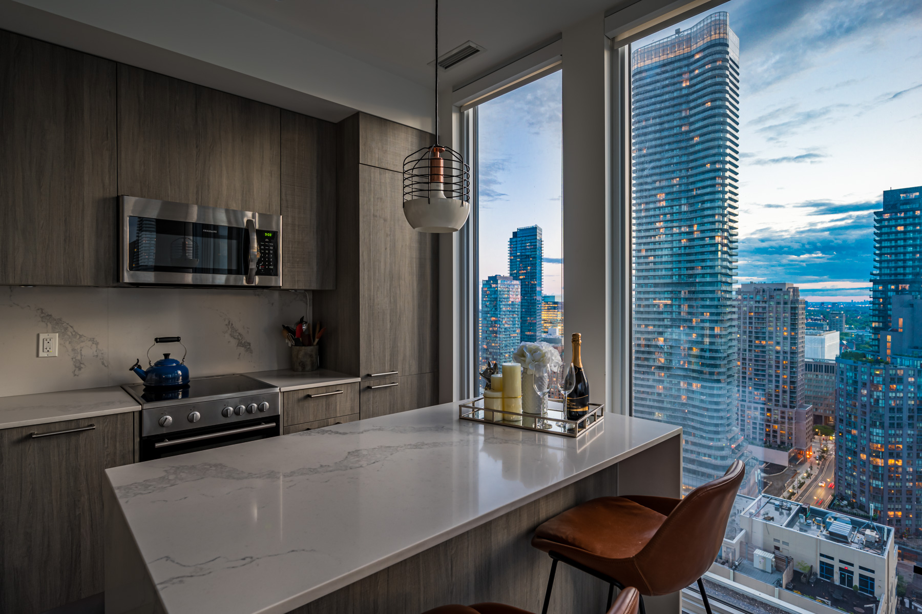 View of Toronto from 28 Wellesley St Unit 3009 kitchen island.