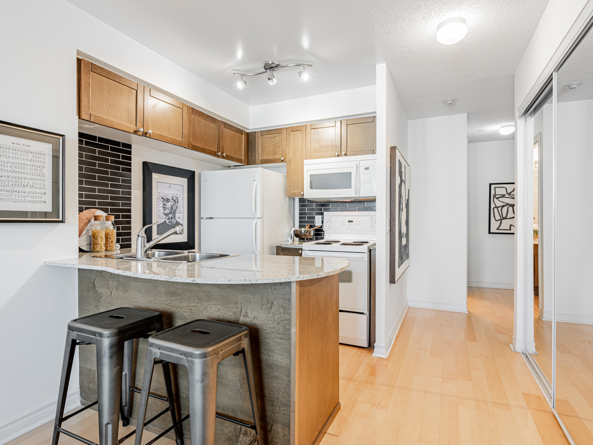 Condo kitchen with curving breakfast bar.