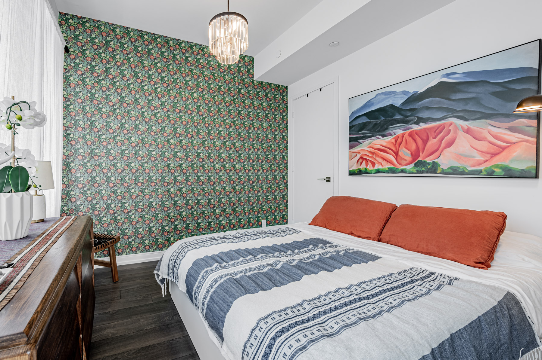 28 Wellesley St Suite 3009 – large master bedroom with chandelier and intricate wallpaper.