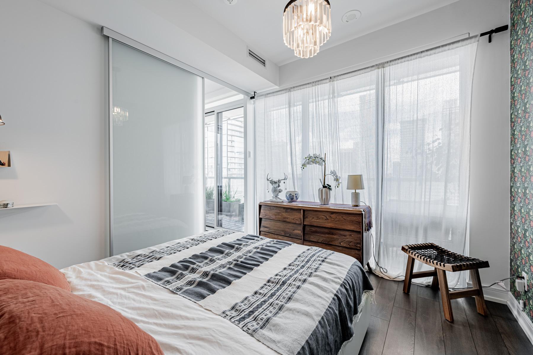 Condo bedroom overlooking balcony.