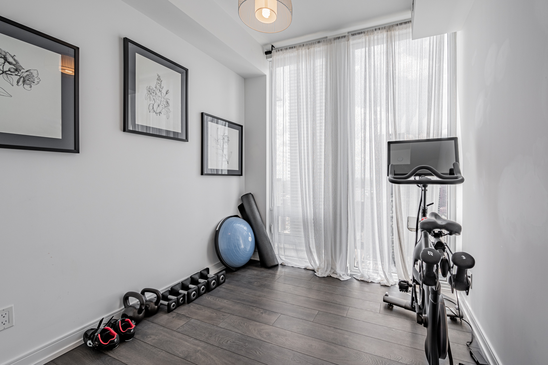 28 Wellesley St Unit 3009 – second bedroom being used as exercise room.