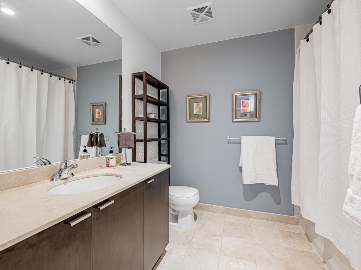 35 Hayden St Unit 1516 large 4-piece bath with ceramic tiles and big vanity.