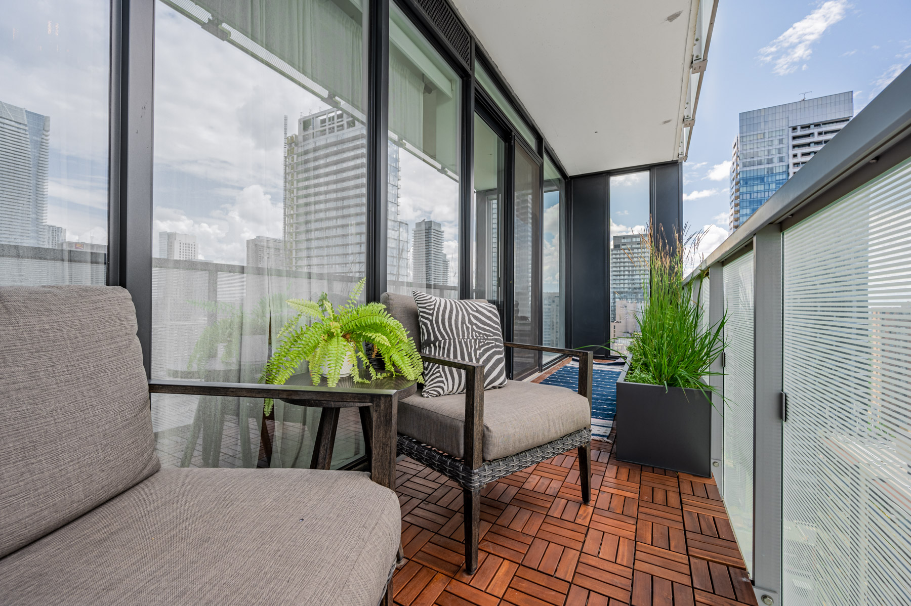 28 Wellesley St Unit 3009 balcony with parquet floors and furniture.