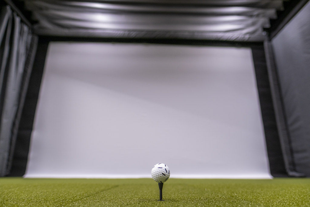 Close up of golf ball and screen.