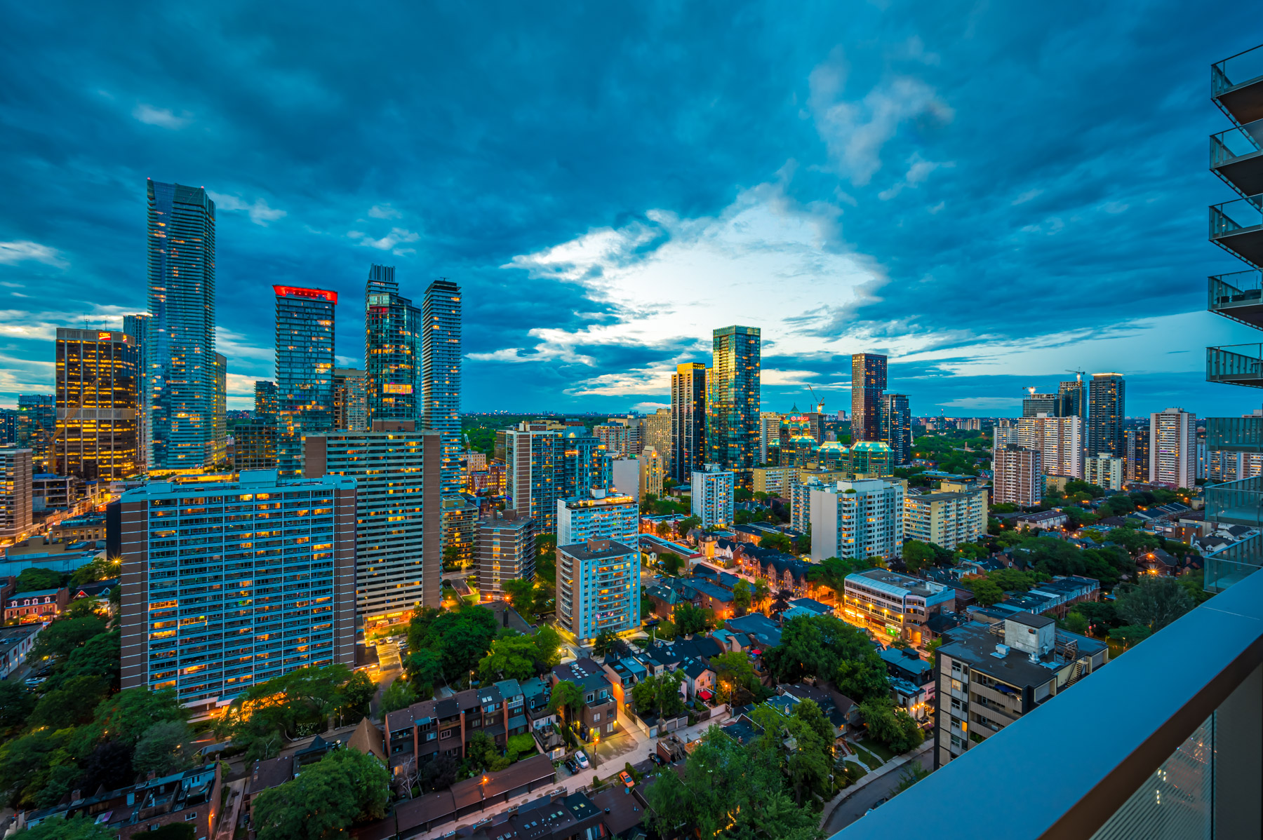View of Toronto skyline at night from 28 Wellesley St Unit 3009 balcony.
