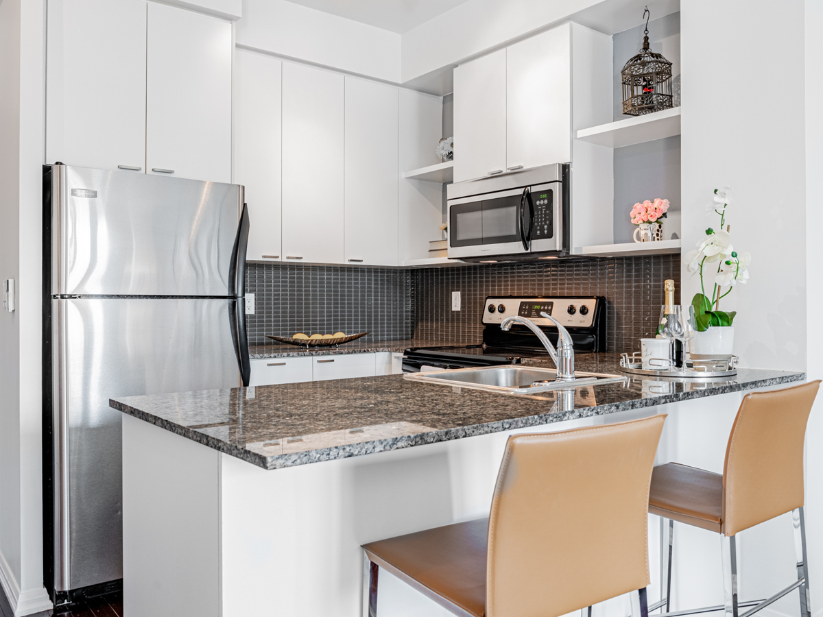Condo kitchen with gray, blacks and silver aesthetic.