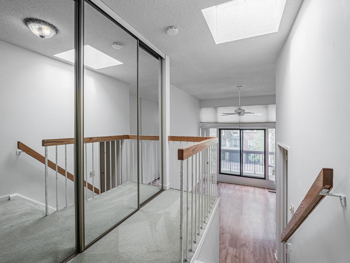 49 Granby St skylight, ceiling fan and mirror door closet.