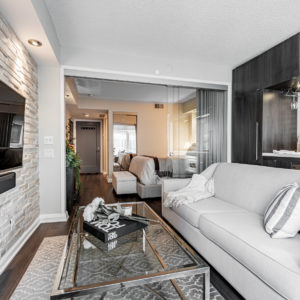 Glass, hardwood, stone and wood materials in 155 Yorkville Ave Unit 712.