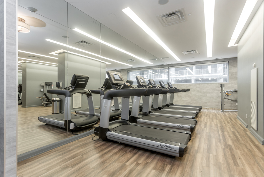 Gym with treadmills at Residences of Yorkville Plaza.