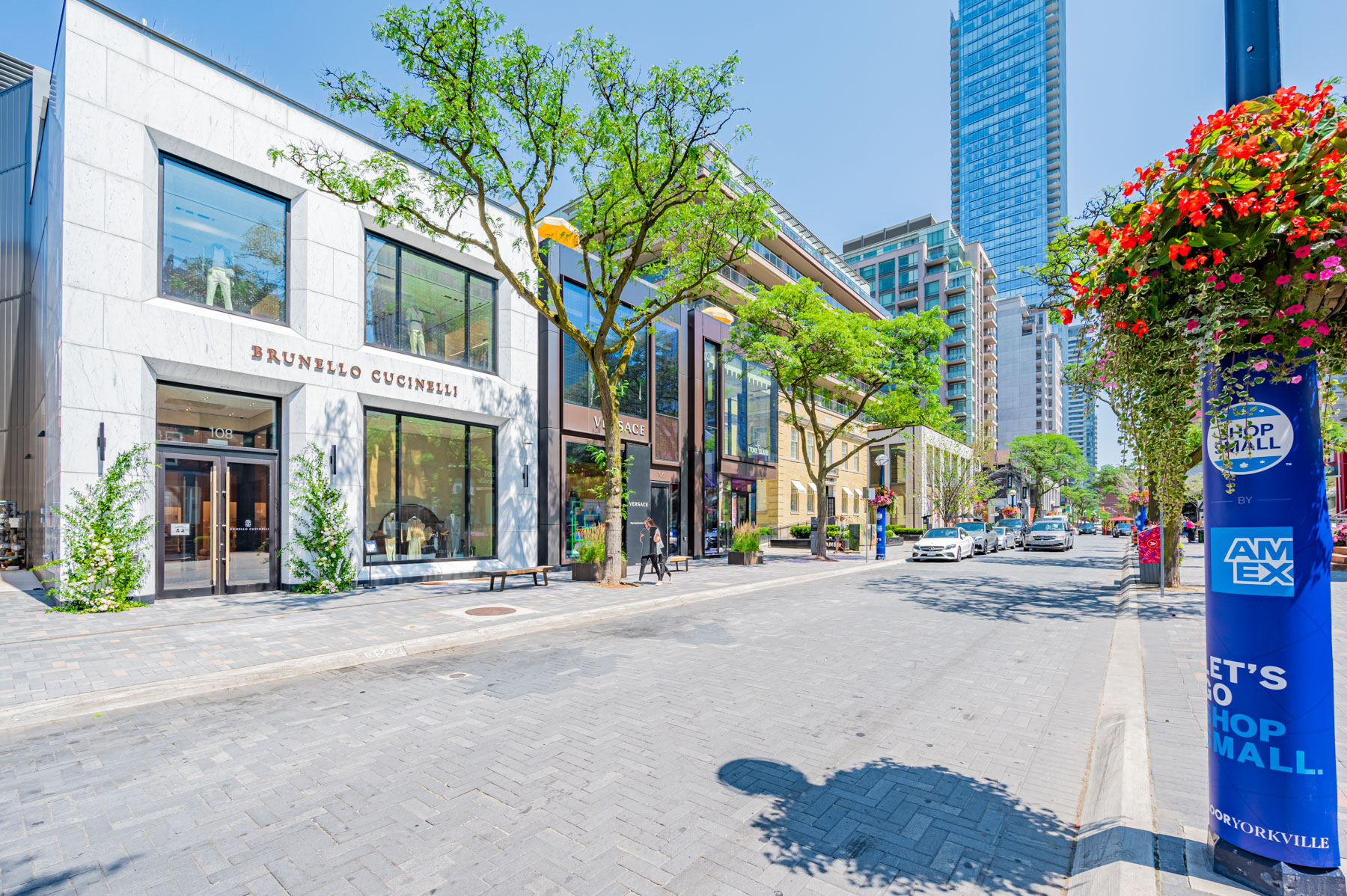 Brunello Cucinelli and Versace flagship storefronts in Yorkville, Toronto.