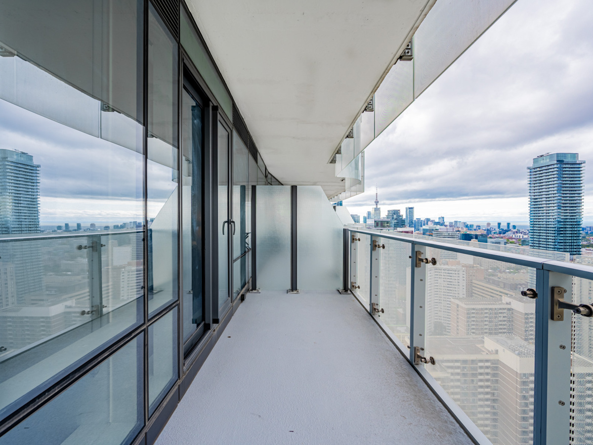 1 Bloor St E Unit 3409 balcony with glazed dividers and semi-transparent glass.