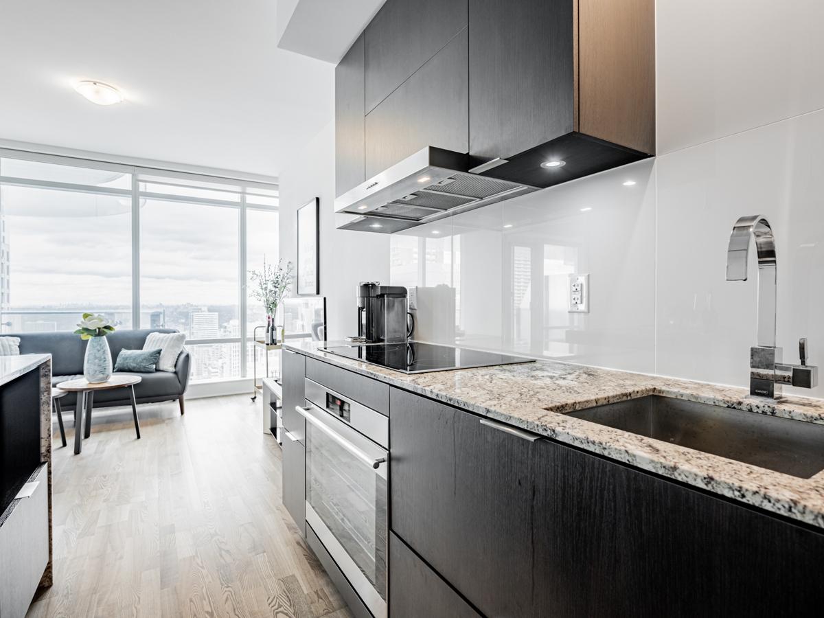 Modern condo kitchen with granite counters.