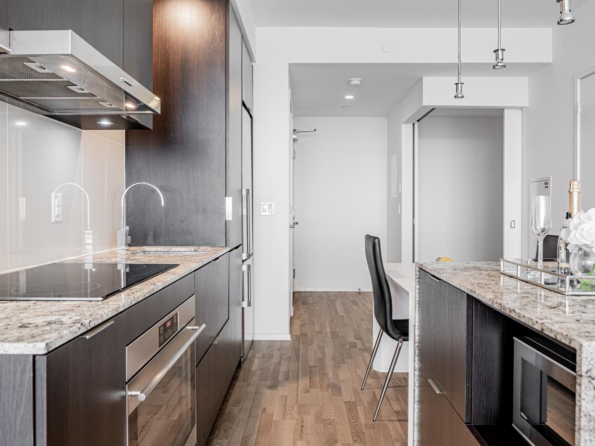 Potlights, pendant lamps and under-cabinet lights – 1 Bloor St E Unit 3409 kitchen.