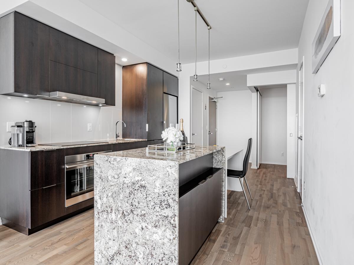 Condo kitchen with granite island.
