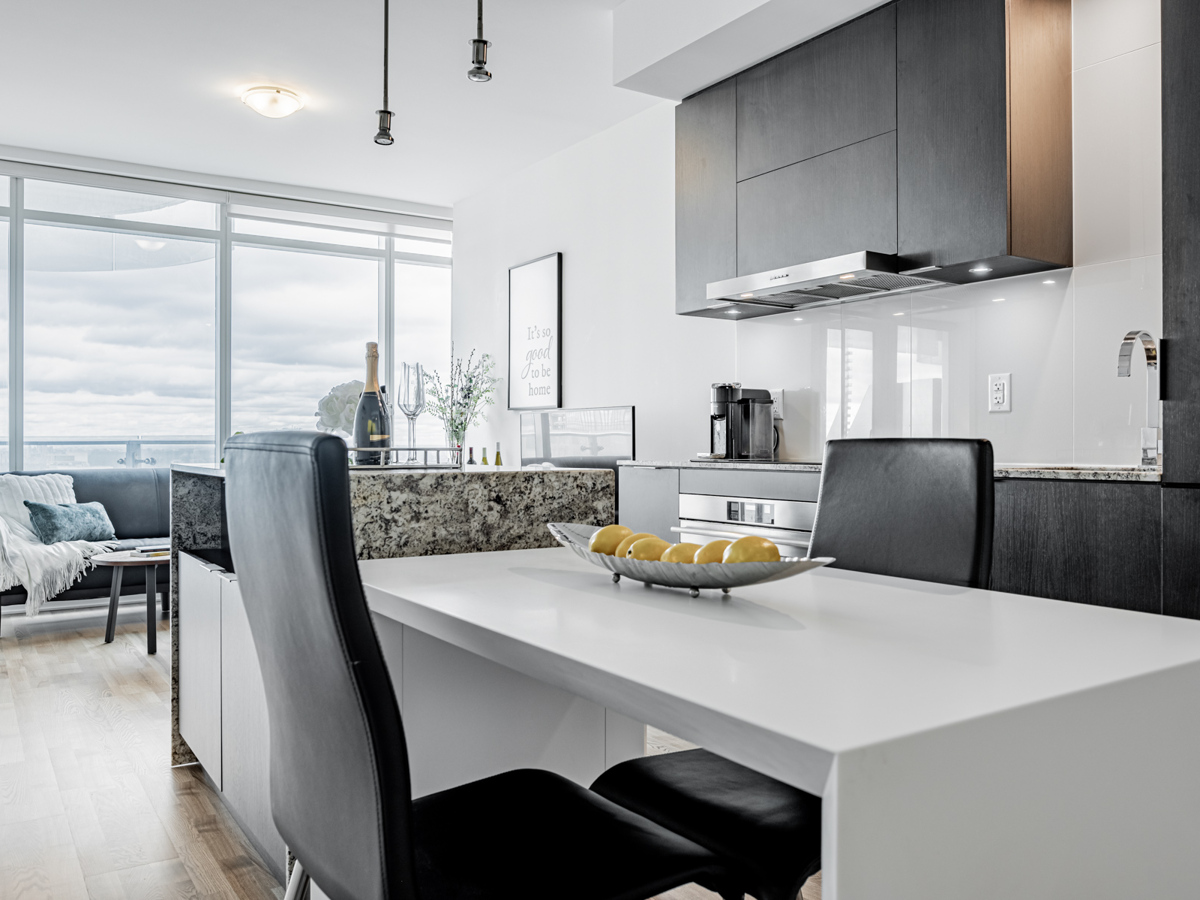 Condo kitchen with white dining table.