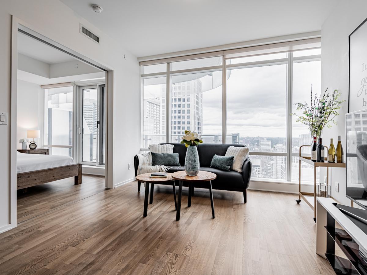 Condo with brown engineered hardwood floors.