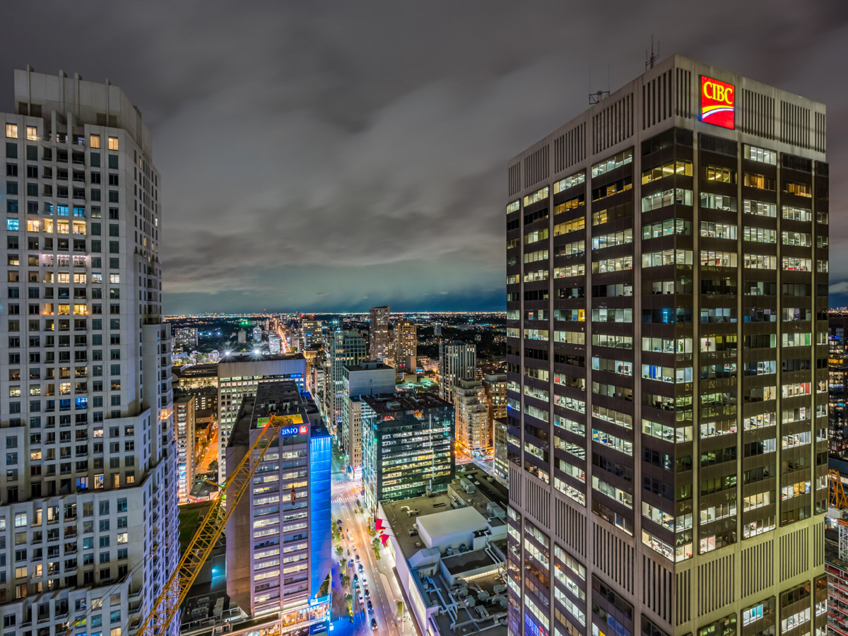 Brightly lit Toronto skyline as seen from 1 Bloor St E Unit 3409 balcony.