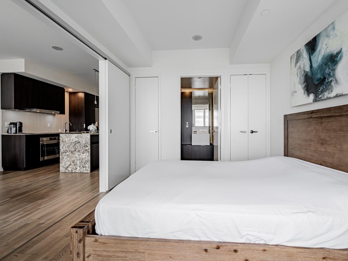Condo bedroom with 2 closets.