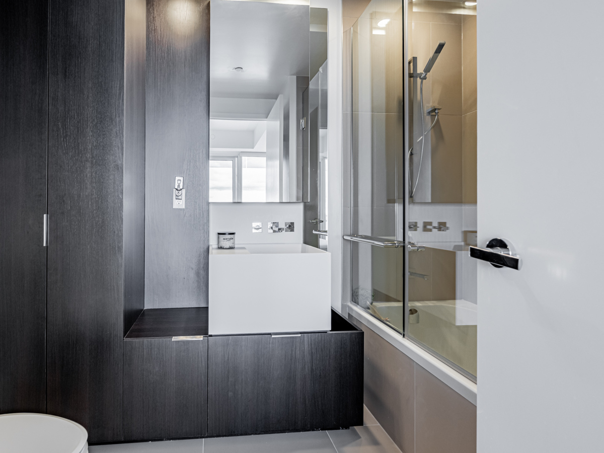 Bathroom with cabinets.