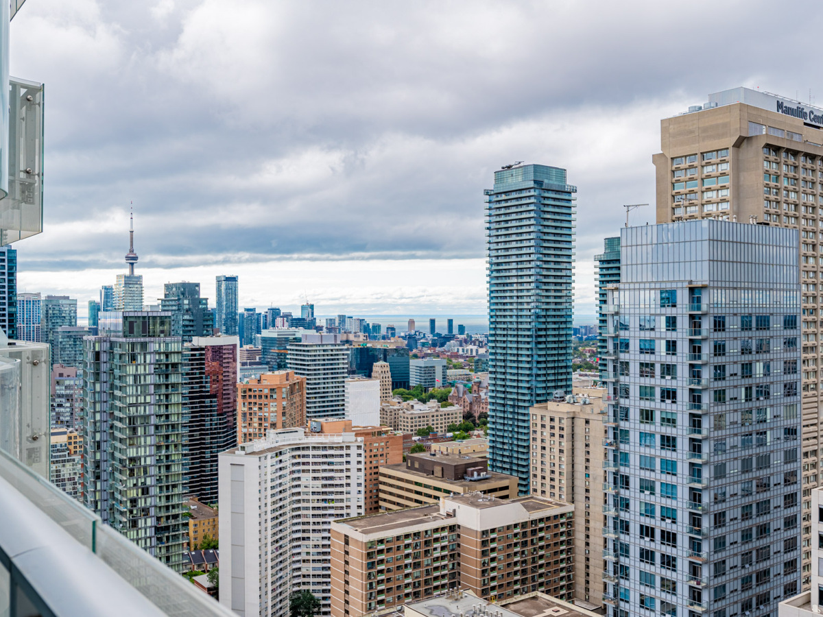 View of CN Tower and Lake Ontario from balcony of 1 Bloor St E Unit 3409.